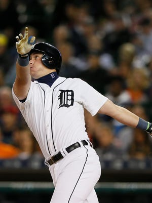 Tigers catcher James McCann hits a two-run home run in the sixth inning Tuesday at Comerica Park.