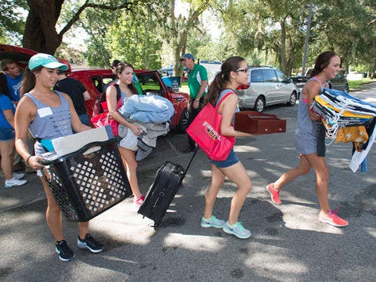 University of West Florida is in the early stages of raising its admissions standards, but at the same time trying to nearly double its enrollment. This file photo from last August shows students moving in for the 2015-16 school year.