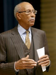 Former Detroit Mayor Dave Bing talks with students from Cody high school at the Charles H. Wright Museum of African American History in Detroit on Thursday, Feb. 26, 2015.