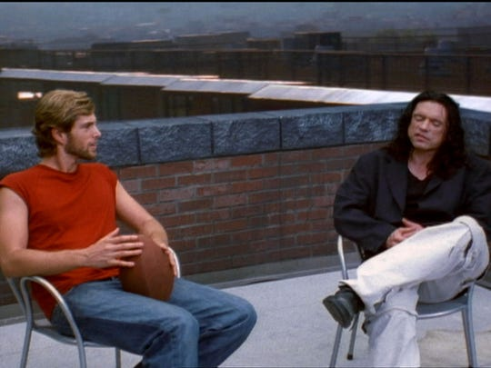 "Greg Sestero as Mark (left) and Tommy Wiseau as Johnny in ""The Room."""