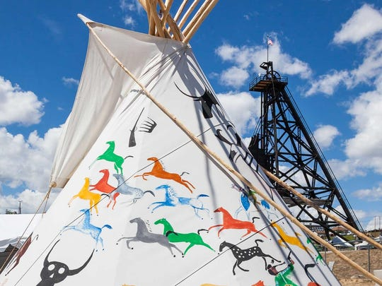 A tepee and the headframe of the Original Mine are paired in this photo from the Montana Folk Festival, which brings together a lively combination of cultures every July in Butte.