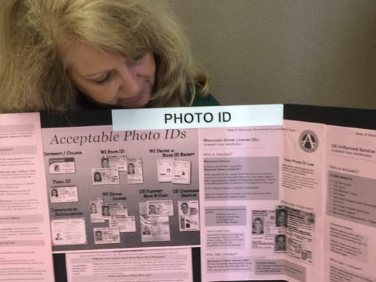 Green Bay City Clerk Kris Teske prepares an information
