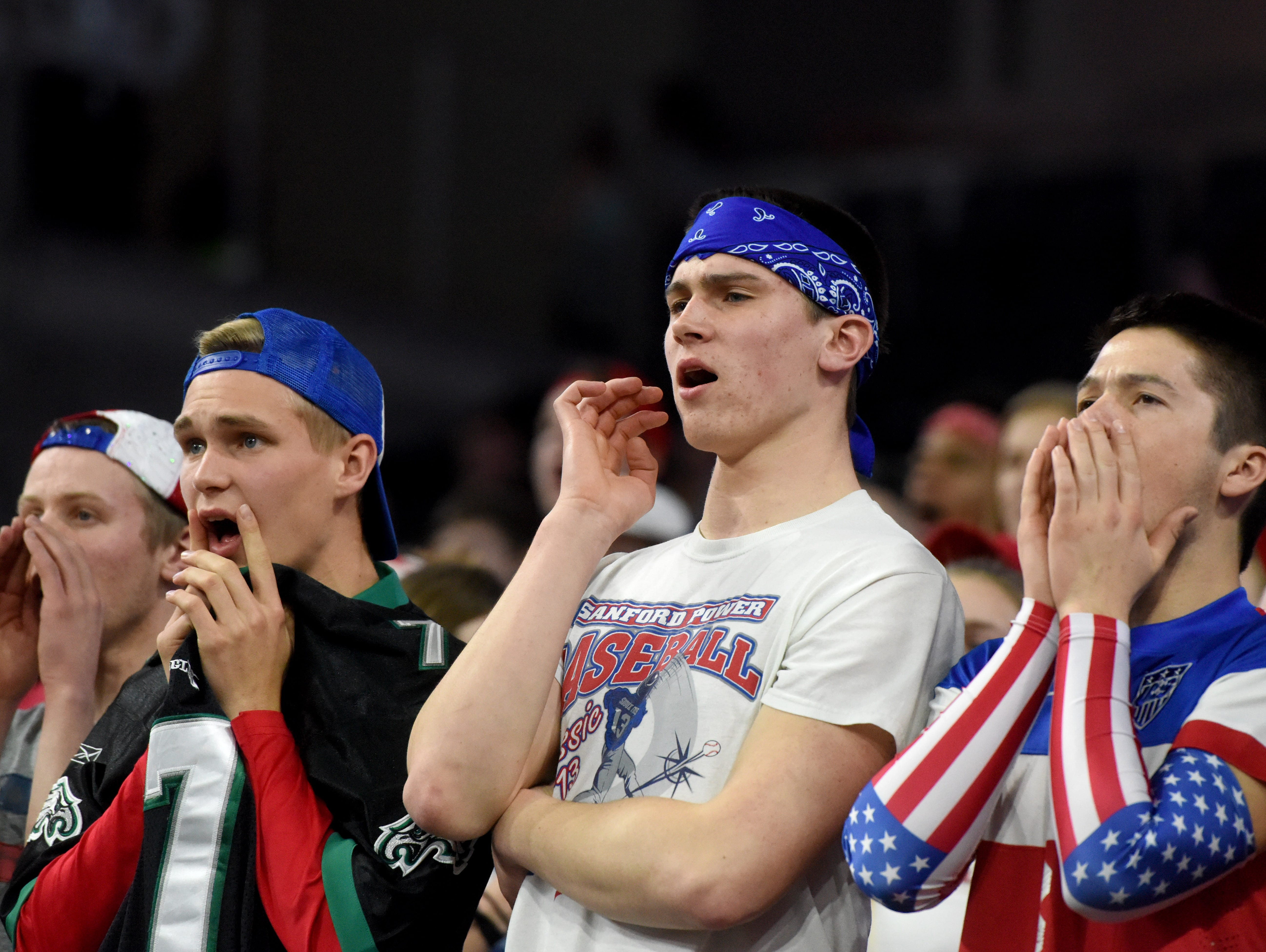 Sioux Falls Christian fans react while their team plays Madison in the 2017 SDHSAA Class A boy's basketball semifinals at the Denny Sanford Premier Center on Friday, March 17, 2017.