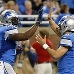 Detroit receiver Calvin Johnson with quarterback Matthew Stafford