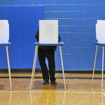 A voter casts his ballot at the Douglass Park Community Center on Election Day, Nov. 4, 2014. Primary elections for municipal offices are set for May 5.