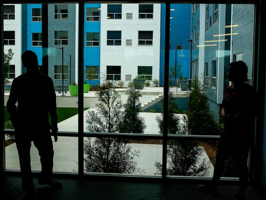 Large glass windows accentuate the views of the central courtyards at the SkyVue apartment complex near the Frandor shopping plaza. The $90 million development opened this year and is praised by Mayor Virg Bernero.