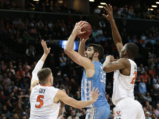 Virginia Cavaliers guard Kyle Guy (5) and forward Mamadi Diakite (25) defend against North Carolina Tar Heels forward Luke Maye (32) during the first half of the championship game of the 2018 ACC tournament at Barclays Center.