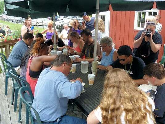 Contestants vie for the ice cream eating trophy at Mulligan MacDuffer Adventure Golf in 2013.