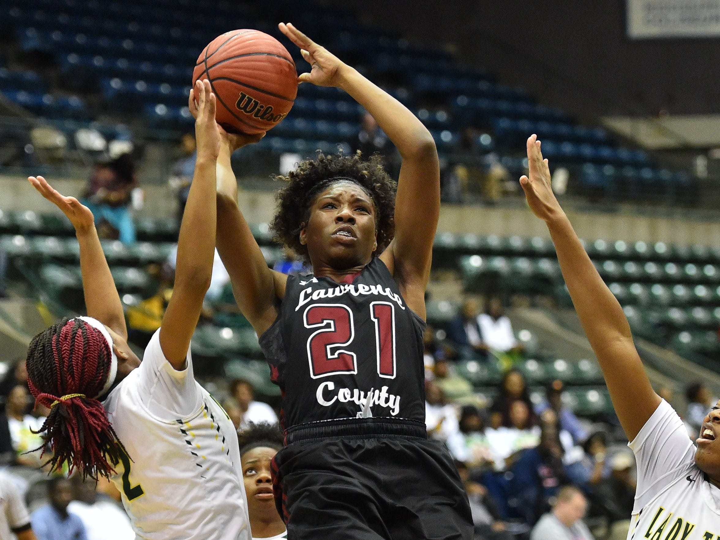 Lawrence County's Kyunna Thomas (21) shoots against McComb during the MHSAA Girls 4A Tournament held at The Coliseum in Jackson MS.(Photo/Bob Smith)