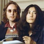 In this April 2, 1973, photo, John Lennon and his wife, Yoko Ono, speak at a news conference in New York. Six months before he died, Lennon set sail from Newport, R.I., on an ocean adventure to Bermuda that awakened his desire to make music again.