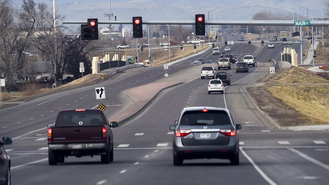 Cars travel Larimer County Road 38 (Harmony Road) near its intersection with Timnath's Main Street in this file photo.