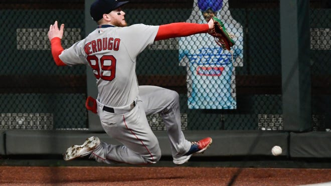 Boston Red Sox right fielder Alex Verdugo cannot catch a fly ball off the bat of Atlanta Braves' Adeiny Hechavarria during the eighth inning of a baseball game Friday, Sept. 25, 2020, in Atlanta.