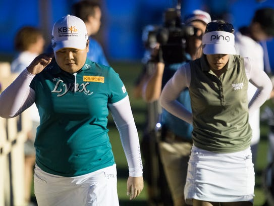 at left, Inbee Park and Pernilla Lindberg walk out