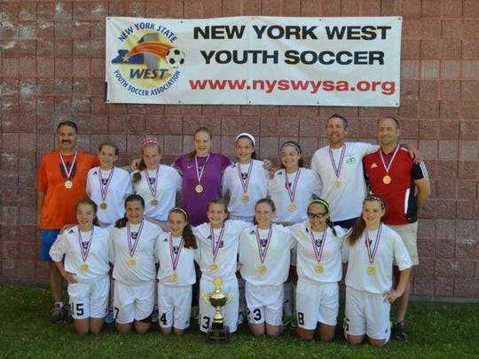 Bahij Kashou, back left, stands with his Greater Binghamton FC U12 girls soccer team that won the New York West Youth Soccer Championships in June.