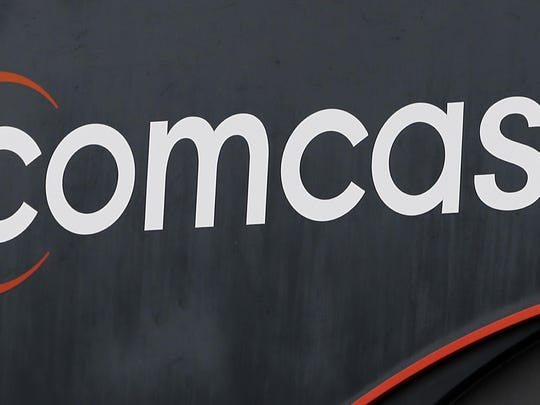 """This Thursday, Oct. 12, 2017, photo shows a Comcast sign in Hialeah, Fla. Now that federal telecom regulators have repealed net neutrality, it may be time to brace for the arrival of internet """"fast lanes"""" and """"slow lanes."""" The Associated Press queried seven major internet providers about their post-net-neutrality plans, and all of them equivocated when asked if they might establish fast and slow lanes. (AP Photo/Alan Diaz)"""