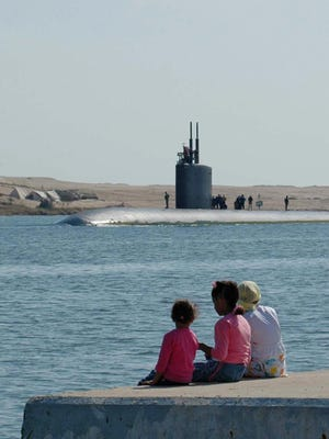 The attack submarine USS Alexandria (SSN-757) passes through the Suez Canal by the Egyptian city of Ismailia, in October 2006 on its way to the Mediterranean Sea from the Gulf.  A U.S. Navy sailor from Vermont is facing sentencing for taking photos of classified areas inside the submarine while it was in port in Connecticut.