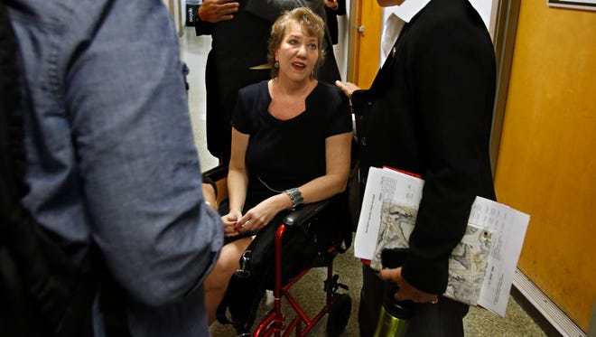Christy O'Donnell, seated, who has terminal lung cancer, discusses right to die in Sacramento on Sept. 10, 2015.