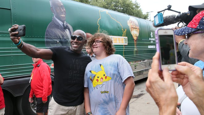 Donald Driver takes a selfie with Oliver Murwin of Janesville.