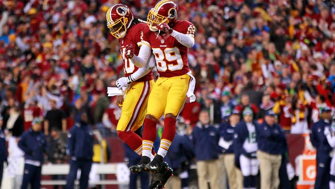 Redskins WR Santana Moss (89) is looking for more celebratory moments with QB Robert Griffin III ... but not until September when they count.