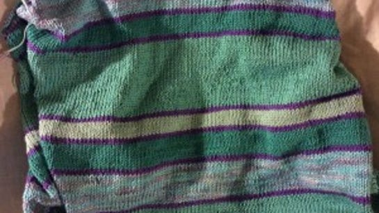 The Mixed Moods sweater has random stripes in shades