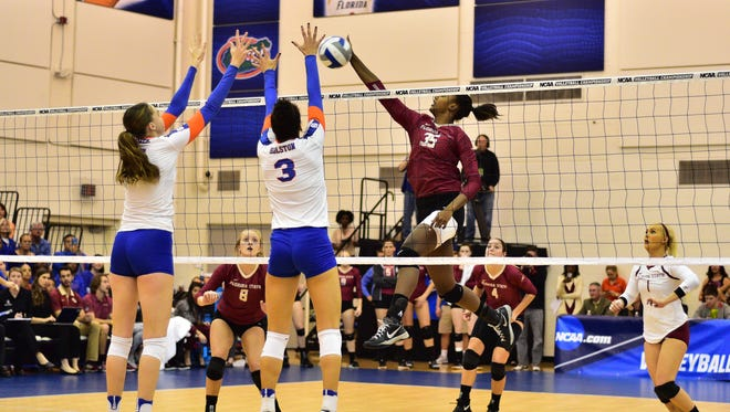 Mara Green (35) prepares to tip the ball past the University of Florida's defense. The Seminoles went on to defeat the Gators 3-2 in Gainesville on Saturday, Dec. 3rd.