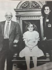 Kyle Arnett, middle, and Carrie Arnett, right, daughters