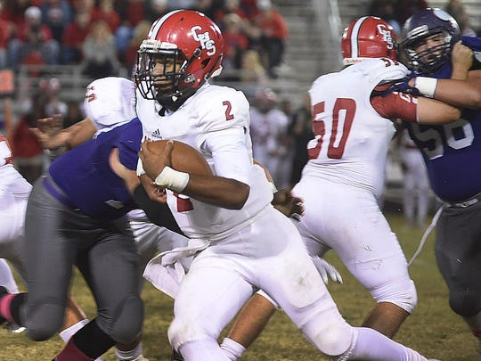 Diallo Landry breaks away from an Opelousas Catholic defender in Catholic High of New Iberia's contest  against Opelousas Catholic Friday at Donald Gardner Stadium in Opelousas.