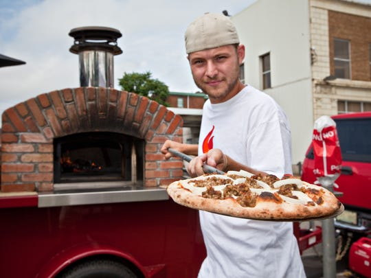 Mike Marschman of Fireside Pizza gets his wagon in gear to deliver wood-fired pies from his pizza oven kit atop a wagon made just for him in Colorado.