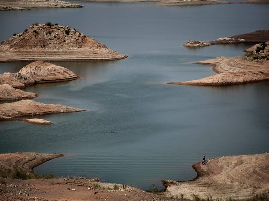 Lines on the shore of Lake Mead show the reservoir's