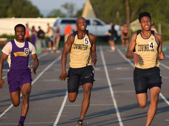 Waynesboro's Jequintus Chambers, left, battles Covington's Kiante Barber, center, and K.J. Moore in the boys 100-meter dash during the Augusta County Invitational track and field meet at Riverheads High School on Friday, April 28, 2017. Chambers placed third.