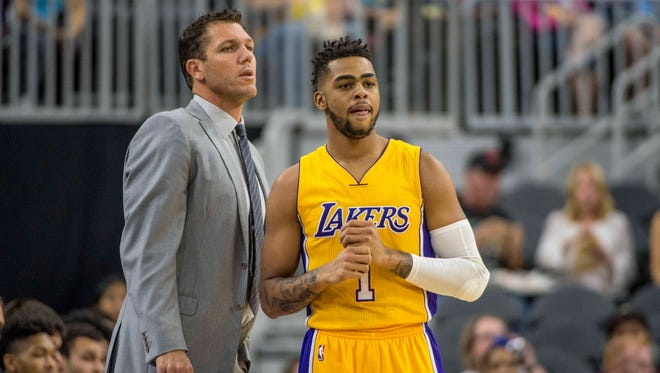 Los Angeles Lakers head coach Luke Walton has had to adjust some things since guard D'Angelo Russell (1) was injured.