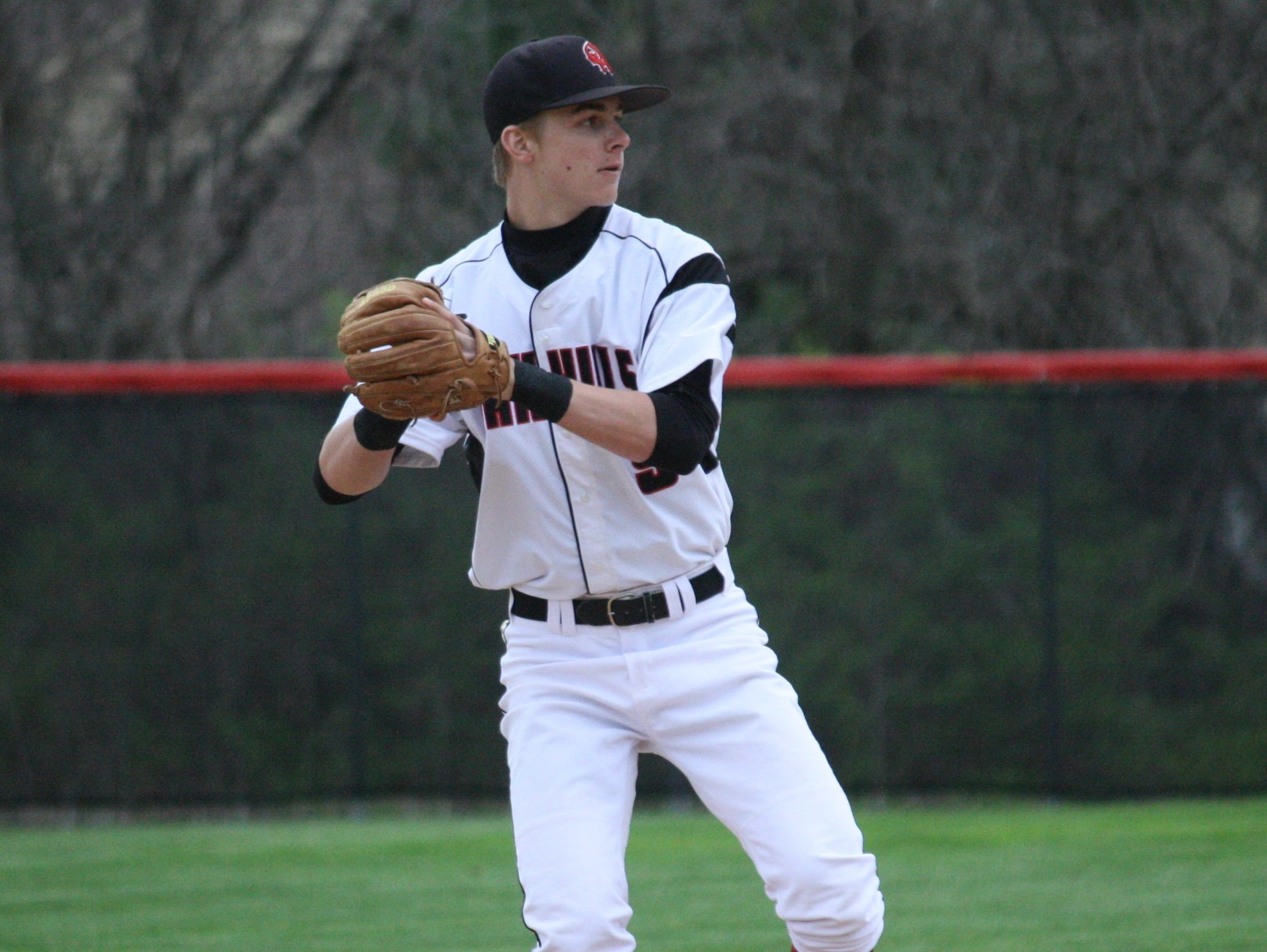 Oak Hills High School senior shortstop Jared Drewes makes a play in the hole against Princeton on April 15 at Oak Hills.