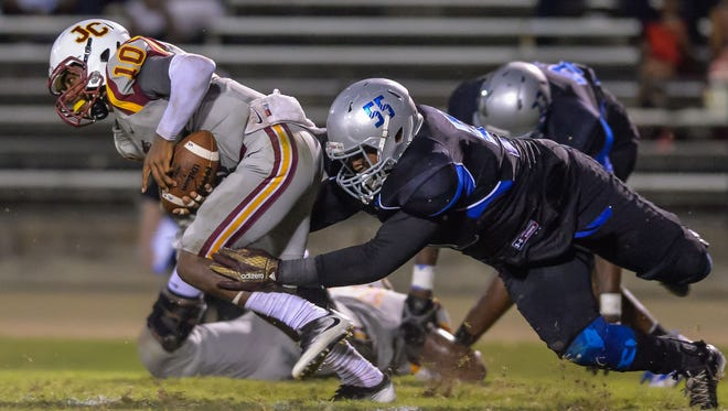 Defensive lineman Deion Pope (55), seen here bringing down Jones County quarterback Detric Hawthorn (10) last year, is going to play a huge role for Jackson State this fall.