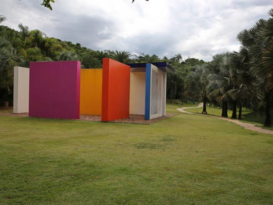 In this Nov. 7, 2016 photo, an installation by Brazilian artist Helio Oiticica is displayed at the Inhotim Institute in Brumadinho, Brazil. The Inhotim Institute is a museological complex featuring a series of pavilions and galleries with works of art and sculptures continuously on display in the open air.
