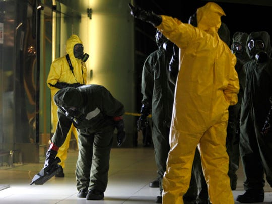 A hazmat crew scan the decontamination zone at Kuala Lumpur International Airport 2 in Sepang, Malaysia on Sunday, Feb. 26, 2017. Malaysian police ordered a sweep of Kuala Lumpur airport for toxic chemicals and other hazardous substances following the killing of Kim Jong Nam.