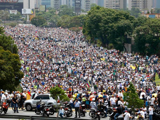 "Anti-government protesters march along a highway in Caracas, Venezuela, Wednesday, April 19, 2017. Tens of thousands of opponents of President Nicolas Maduro flooded the streets of Caracas in what's been dubbed the ""mother of all marches"" against the embattled president."