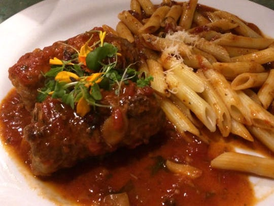 Vincent's braciola was two luscious rolls of thin, tender beef stuffed with pine nuts, raisins, garlic, Parmigiano, parsley and bread crumbs and braised in a tantalizing tomato sauce.
