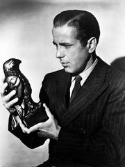 "Humphrey Bogart holds the coveted bird that everyone seemed to want in ""The Maltese Falcon."""