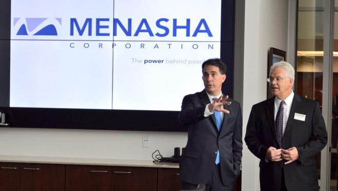 Gov. Scott Walker talks with Jim Kotek, president of Menasha Corp., at a ribbon cutting ceremony on Sept. 7, 2016.