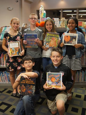 Children who attended an evening story time at Franklin Township Library enjoyed Halloween and harvest-themed stories. Janelle Eubanks, Brett Cronk, Annalise Eubanks, Victoria Conley, Ian Hoban and Wheaton Link, members of the Delsea Regional Middle School Storytellers Club, shared the stories.