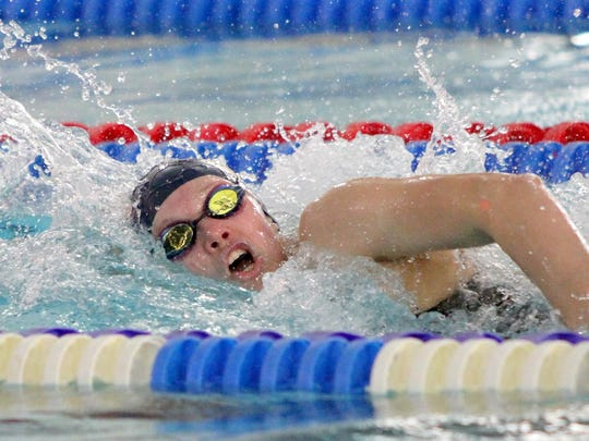 Notre Dame's Frances VanderMeer competes in the Section 4 Class A championships last year. She is one of eight swimmers back for the Crusaders.