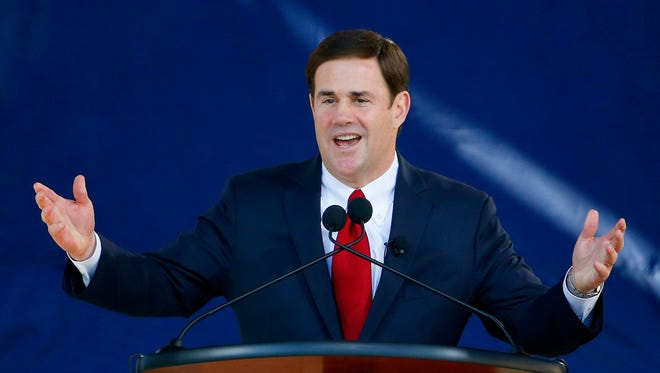 Arizona Gov. Doug Ducey said he will sign a bill requiring a civics test for the state's high-school students.
