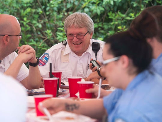 Paramedic supervisor Jim Meadows enjoys lunch at the downtown Knoxville fire station Saturday, July 29, 2017. Knoxville man Larsen Jay threw the lunch to thank local emergency workers for responding to a life threatening accident he had 10 years ago.
