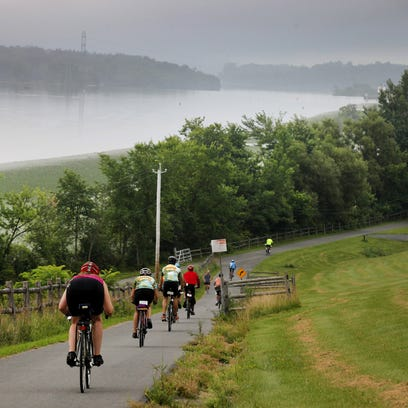 Cyclists on the Cycling the Erie Canal head downhill