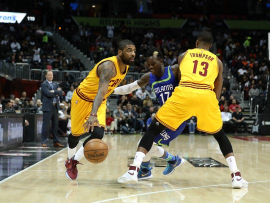 Cleveland Cavaliers guard Kyrie Irving is defended
