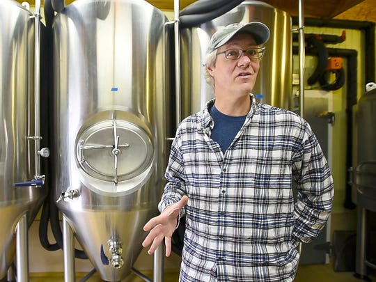 Sean Lawson of Lawson's Finest Liquids at his seven-tank brewery next to his home in Warren on Tuesday, May 2, 2017.  Lawson is planning to expand into a two-building complex in Waitsfield that will include a brewery and tap room.