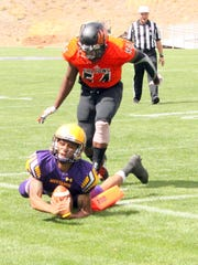 Western quarterback Javia Hall dives toward the pylon to score this touchdown Saturday against Permian Basin.