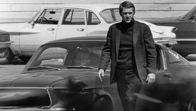 """Steve McQueen, starring in the title role of """"Bullitt,"""" steps out of his car after a 140-mile-an-hour pursuit through the hilly streets of Russian Hill in San Francisco. The Technicolor action drama was filmed entirely on location in the City by the Bay."""