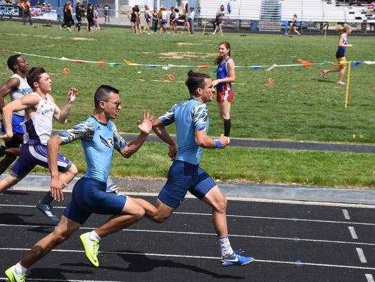 James Lara and Peter Hile in the 200m sprint Saturday.