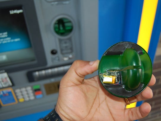 This type of credit card skimmer is placed on the ATM's